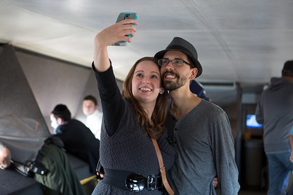 Couple taking a selfie at the top of the Arch
