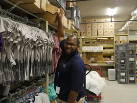 Arch Store employee in stock room