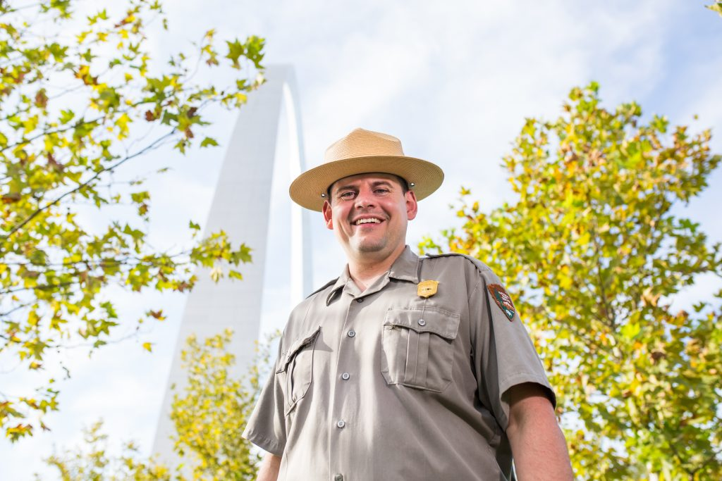 National Park Service Ranger in front of Arch