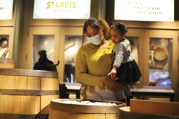 Woman and child exploring museum